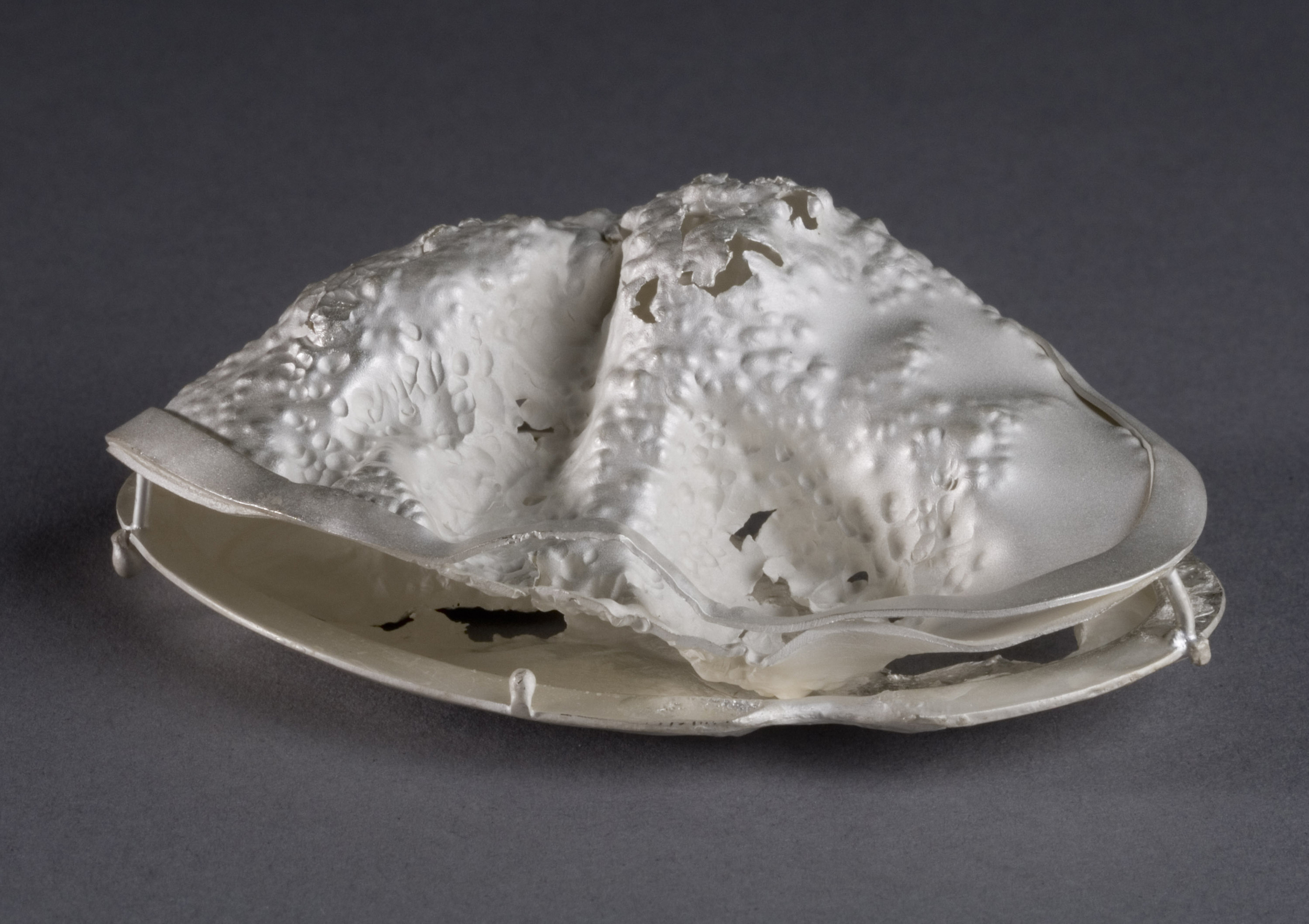 inconsolable  | Opposite Side of Back Center Object from Detail 9 | Silver | 2009