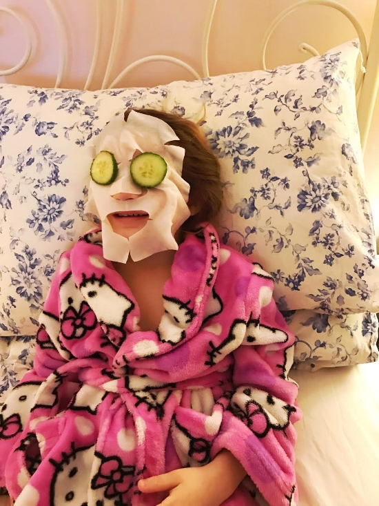 Ph: Honor chillaxing whilst wearing a face mask - she requested the cucumbers.