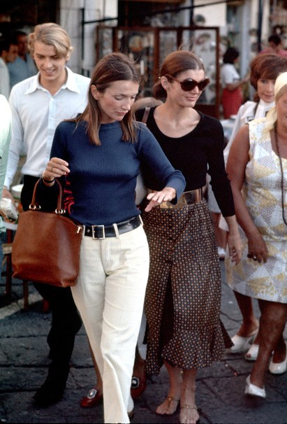 Lee and Jackie, photographed by Ron Galella, while shopping on Capri, in Italy, 1970.