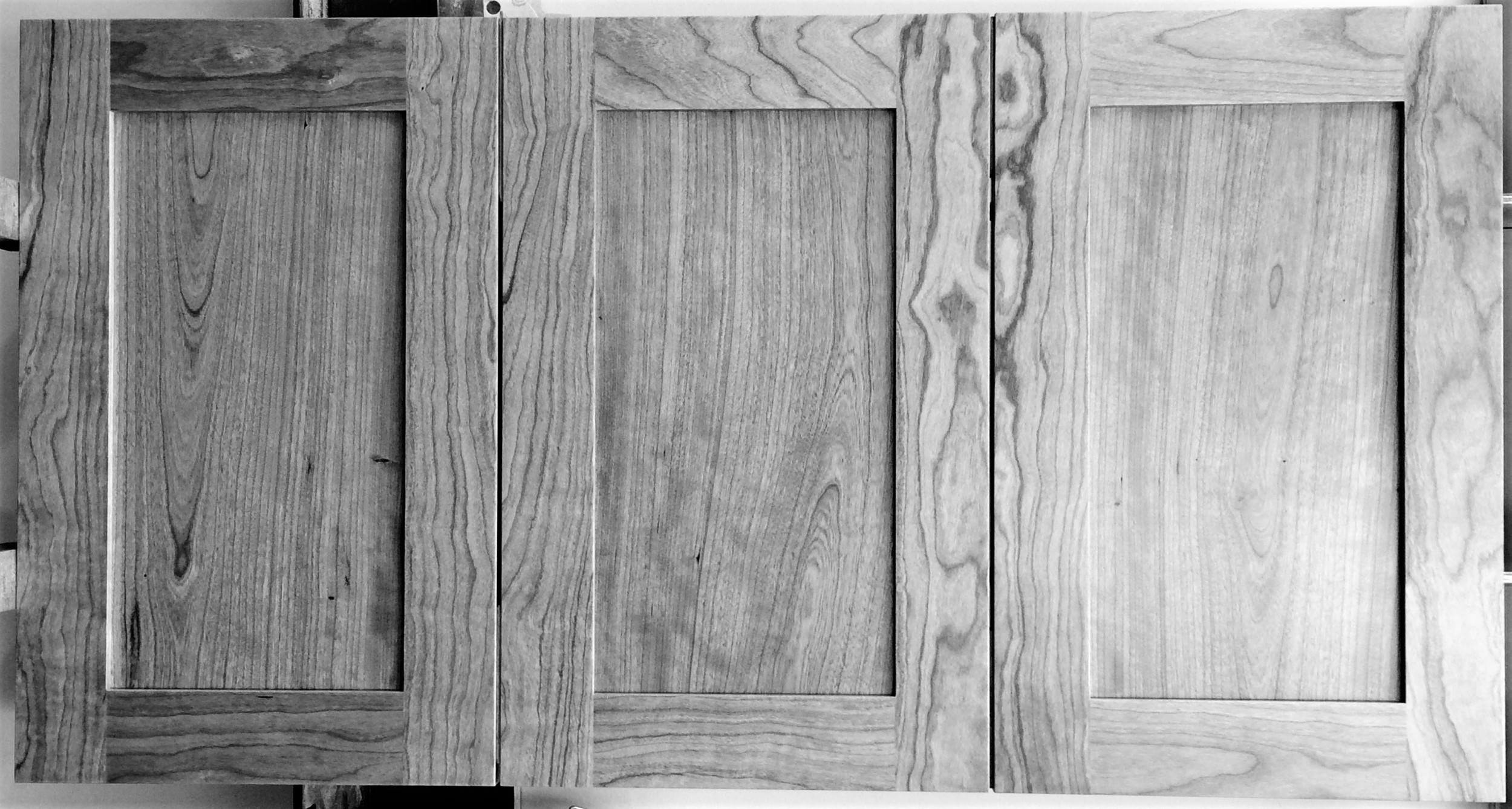Grain matched Shaker style cherry doors.