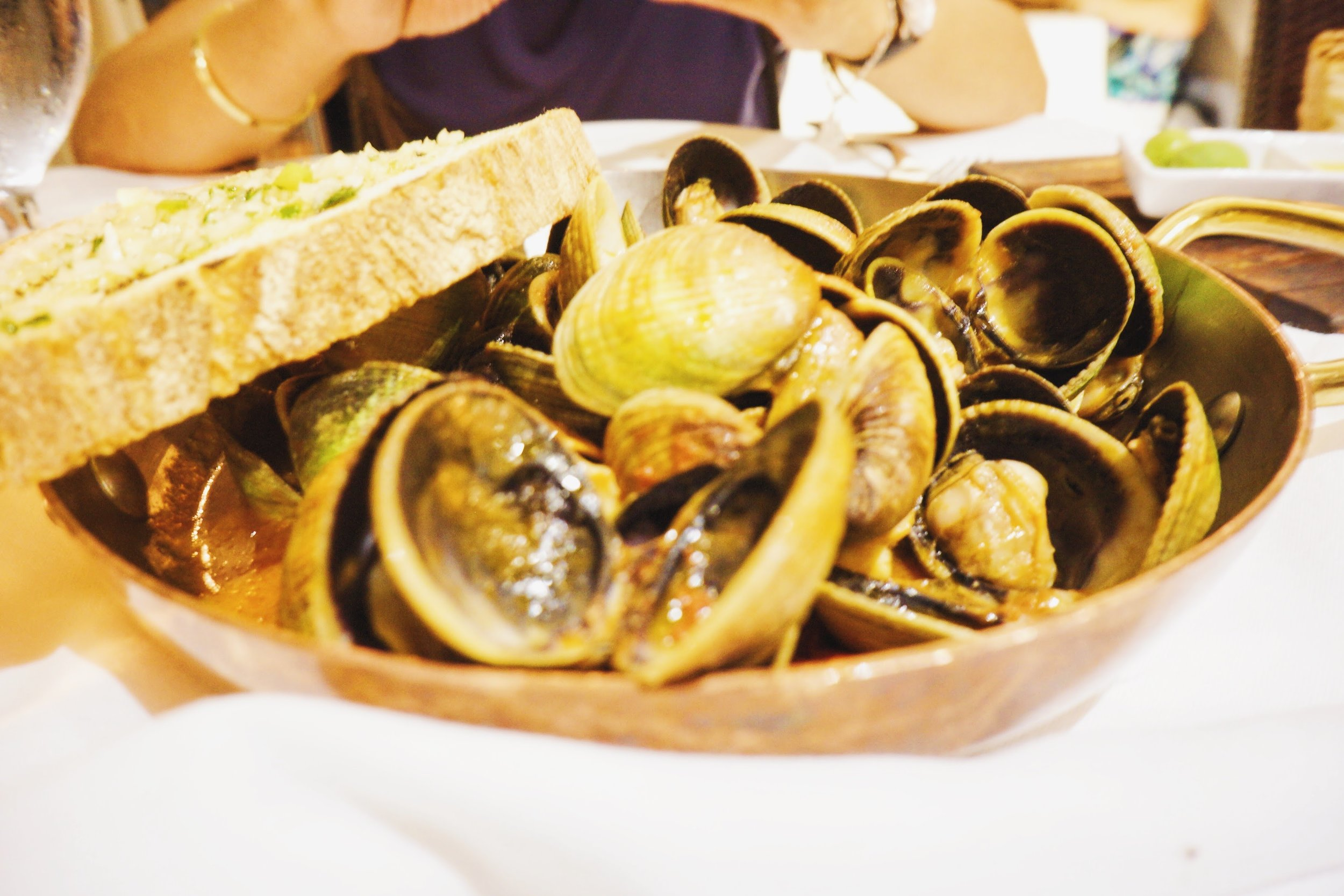 Clams in a spiced tomato broth.