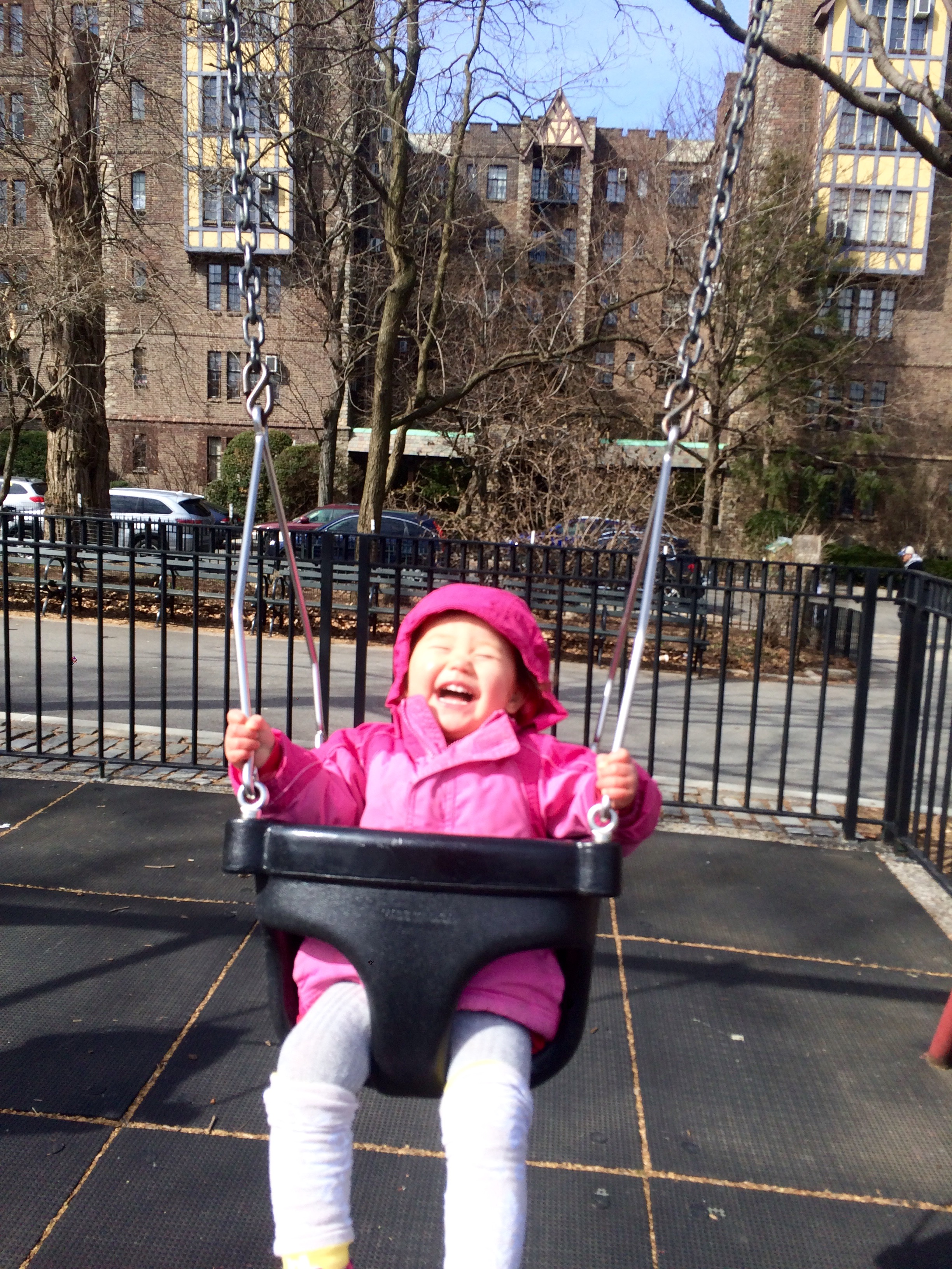 Luna, happily swinging at one of our neighborhood playgrounds.