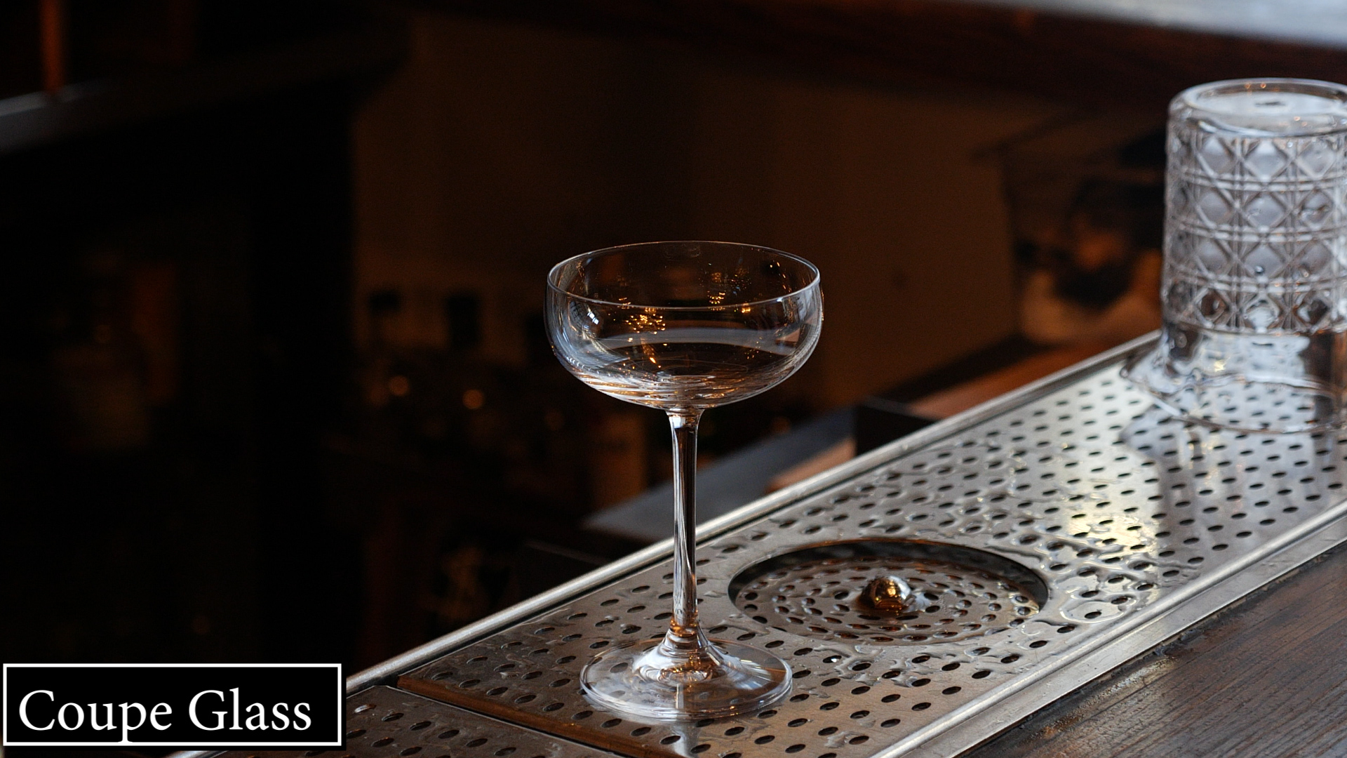 """This was the original Champagne glass! Famously believed to be modeled after a French Queen's body part, was actually introduced a century before her time - in 1663! It lost popularity as a vessel for sparkling wines because the bubbles dissipated too quickly into the nose. The flute soon became the preferred glass for that purpose. However, the coupe got a big boost in popularity from the post-prohibited United States in the 1930's as the original cocktail glass. [See the famous picture of President Franklin D. Roosevelt toasting the end of Prohibition with a Martini!]  The coupe is used for any drink that is served """"up"""", such as the Martini, Manhattan, Sidecar, Whiskey Sour, Gin Fizz. There's  never  any ice in this glass - and every cocktail that is poured out of a tin and into a coupe should be double-strained.  TIP:  Generally, it's a good indication of the quality of cocktail you might expect from an establishment if you see coupe glasses lined up at the bar. First, you'll see that people are drinking cocktails (not just beer), but second, you'll know that the bar takes its glassware seriously. The 'Martini' glass with the wide, sharp, cone-like shape gained popularity in the 1980's as bartenders were adding more ingredients, cocktails like the Cosmopolitan came around and everything was about being bigger, better, and wackier then ever. The 'Martini' glass proved to be more fun than functional, as it turns out, and it was a fad that led to a lot of spilled drinks and broken glass! For years, bars would stock up on Martini glasses that measured anywhere from 5 to 10 liquid ounces at the top - imagine what a proper Gimlet (2oz Gin, ½ oz lime juice, ½ oz simple syrup, shaken with ice) would look like in a glass that big!"""