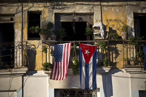 Split allegiances, a photo taken in Havana, Cuba by Ramon Espinosa/AP