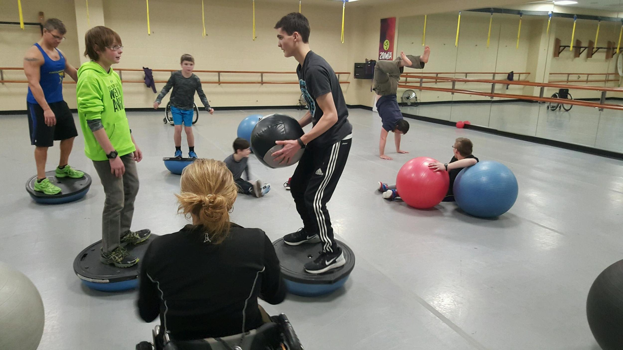 Doing some balance training in the gym with medicine and bosu balls.