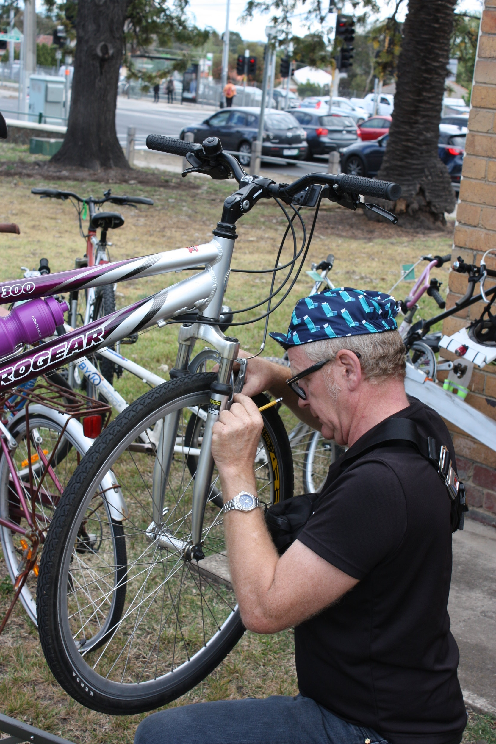 - Richie adjusting the brakes on a commuter's bike