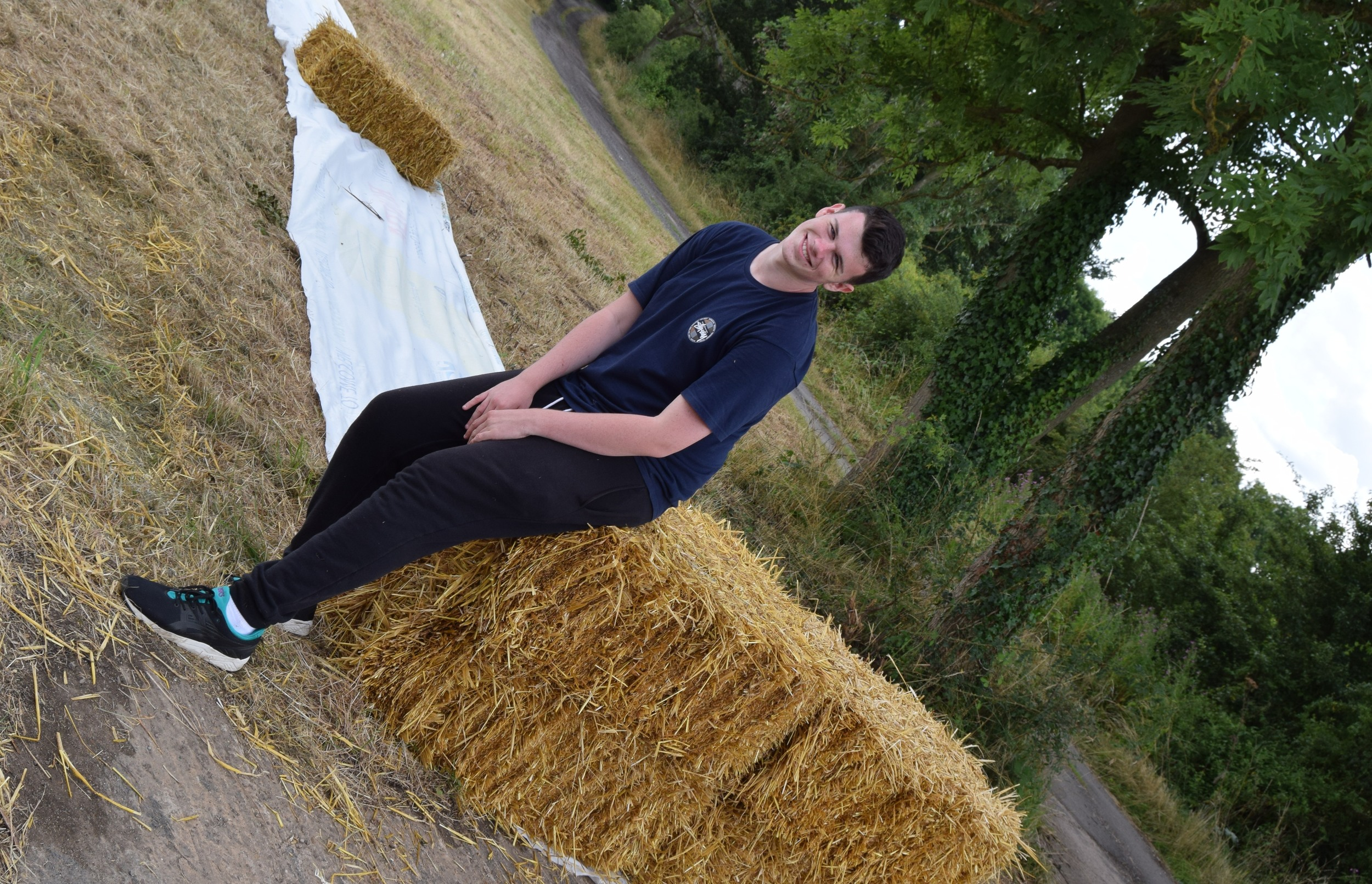 Jack chills on a stra bale.JPG