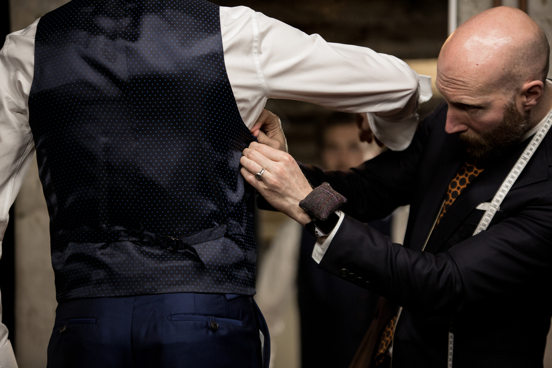 FInal adjustments being made to the waistcoat of James' wedding suit.