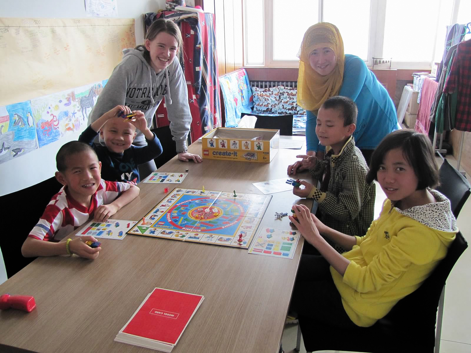 Jodie's family hosting and playing games with Chinese Muslim friends.