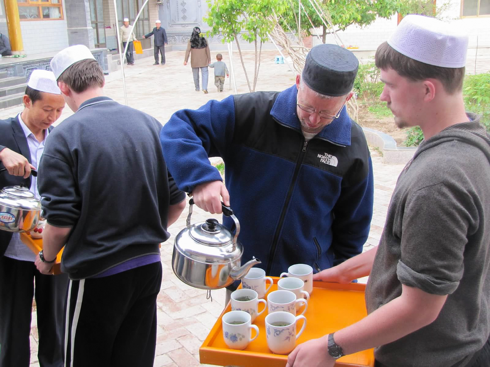 Filling cups of tea to serve