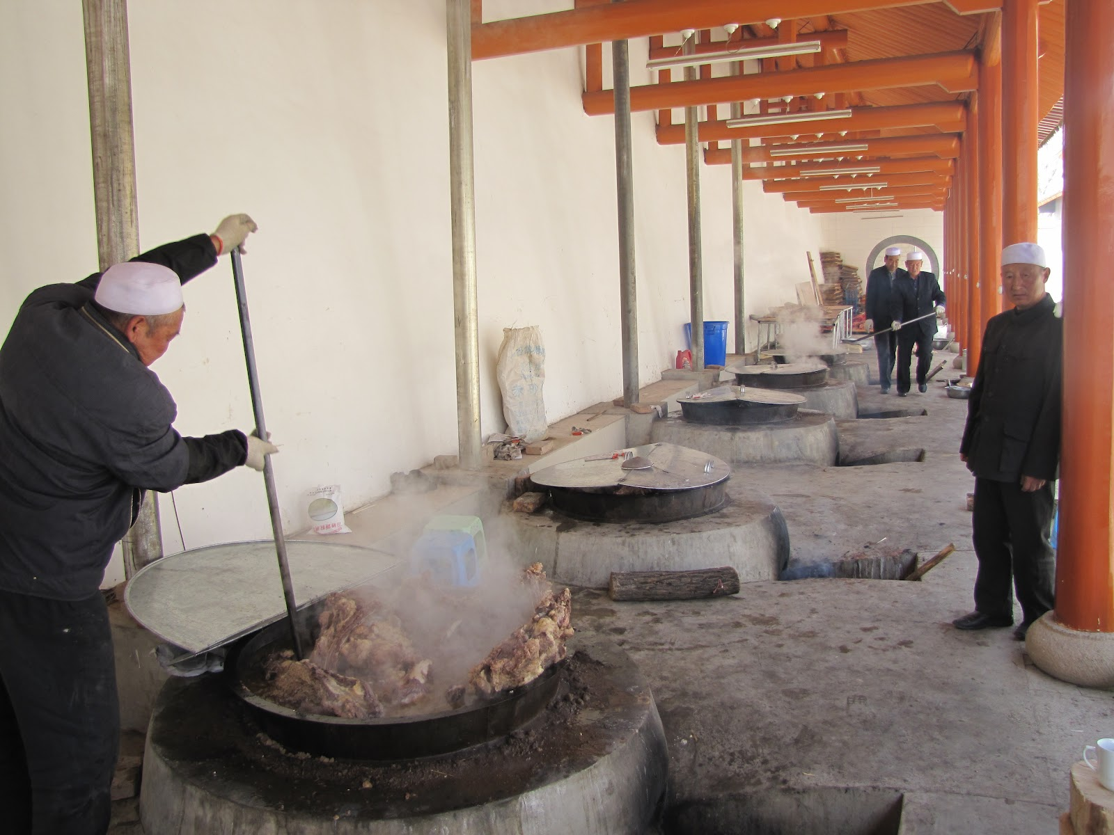 Stirring large pots of beef before the festival