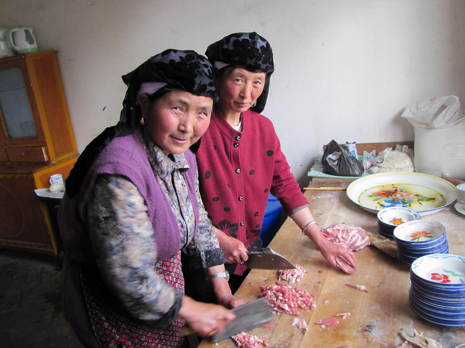 Women preparing meat for the festival