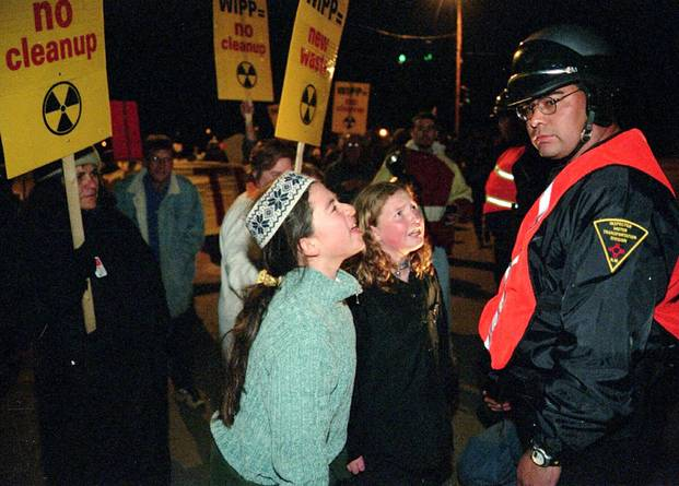 """Two twelve-year-old girls yell at an officer overseeing nuclear waste transport to the WIPP facility in 1999.""  Source:  Sarah Martone/AP"