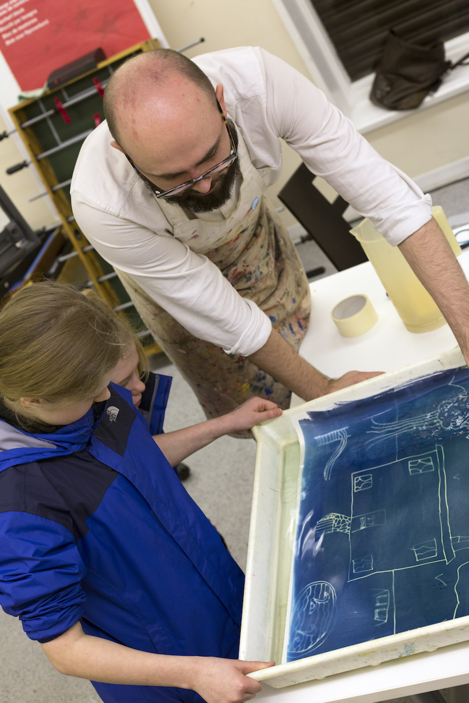 developing the plans into real blueprints (or cyanotypes) using a chemical solution