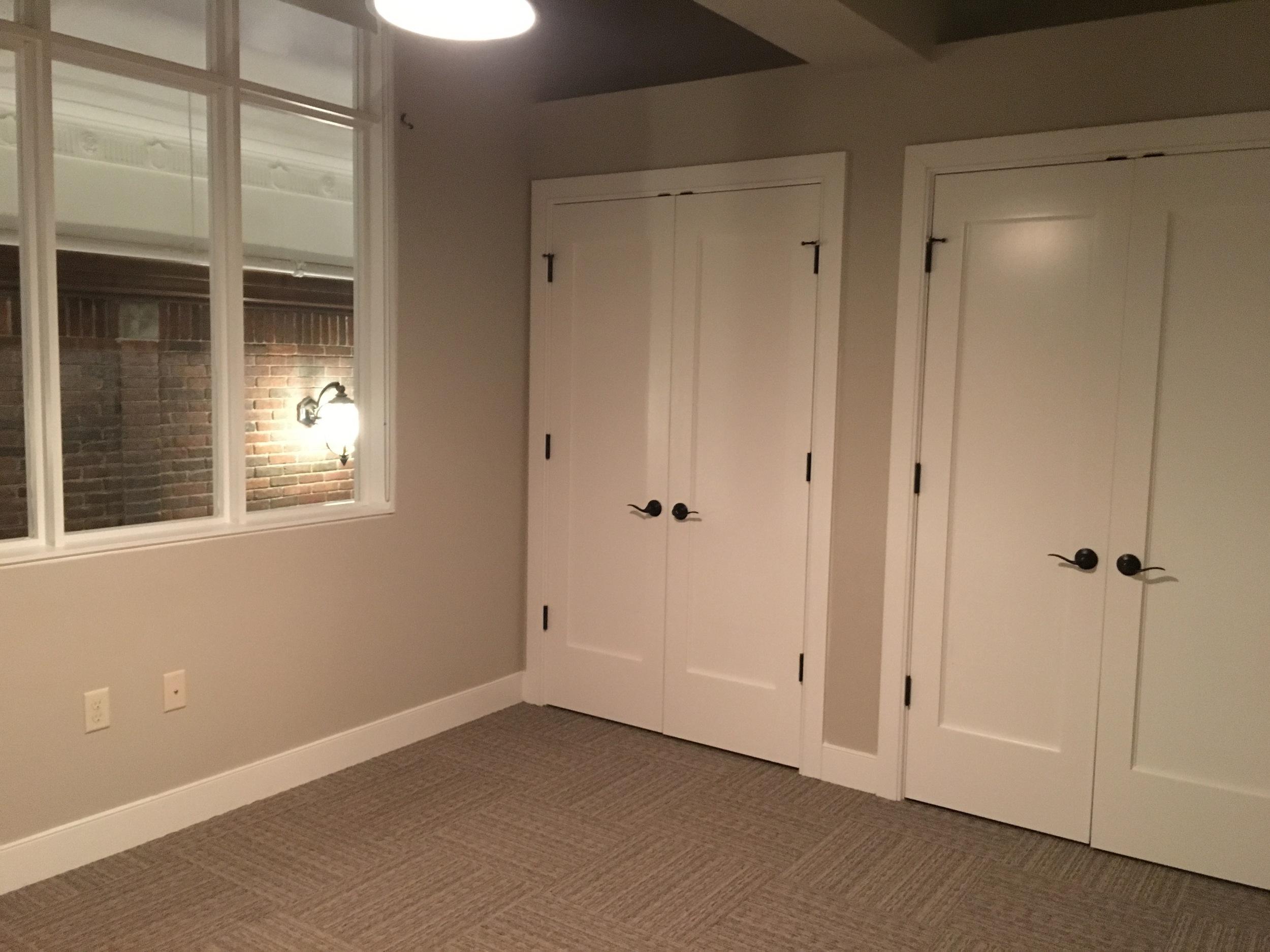 Second floor master bedroom with a window overlooking the hallway.
