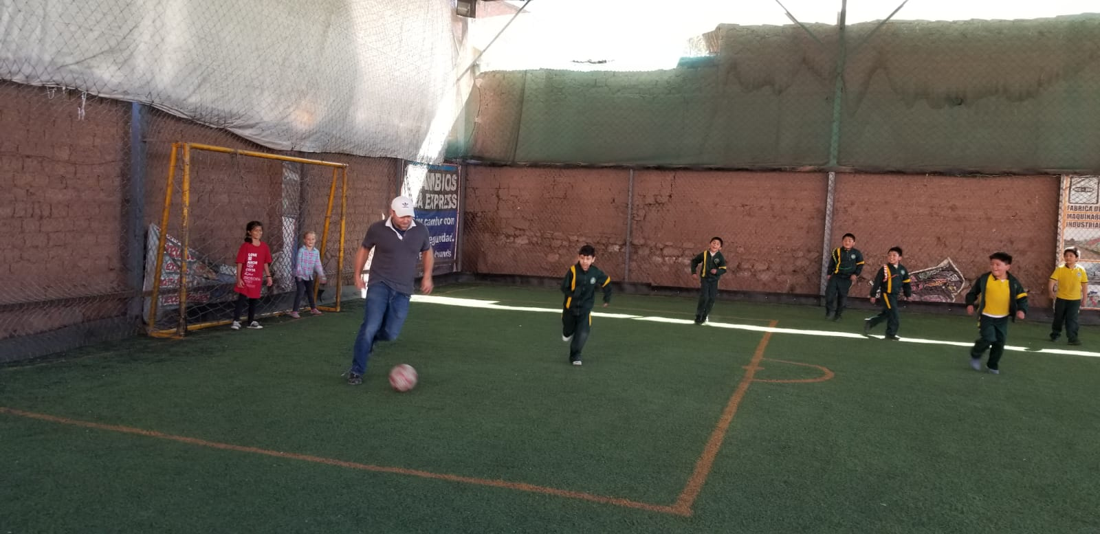Josh playing soccer with the second graders.  Joelyn and Lily were the goalkeepers.