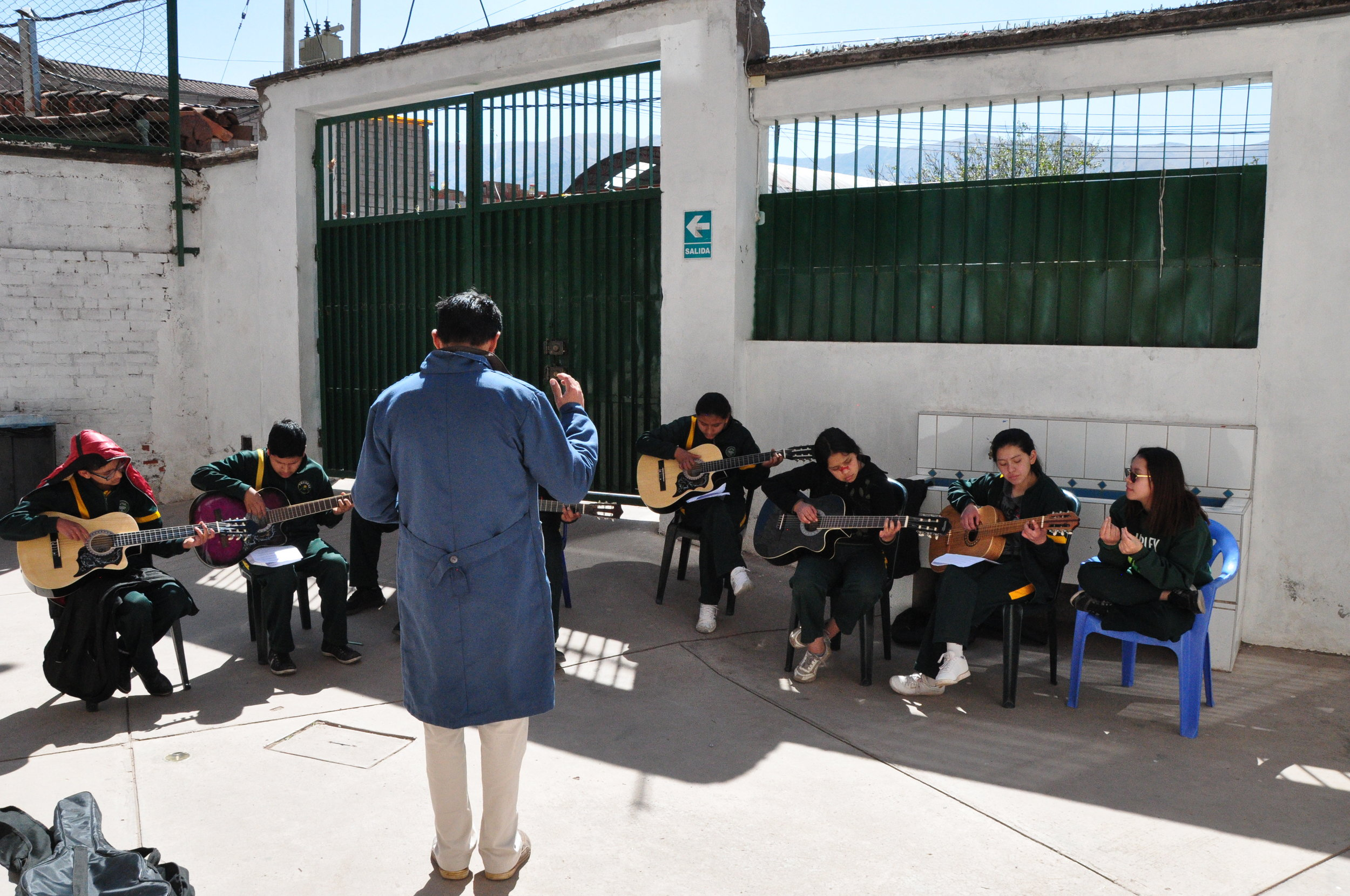 Guitar class held outside due to limited classroom space