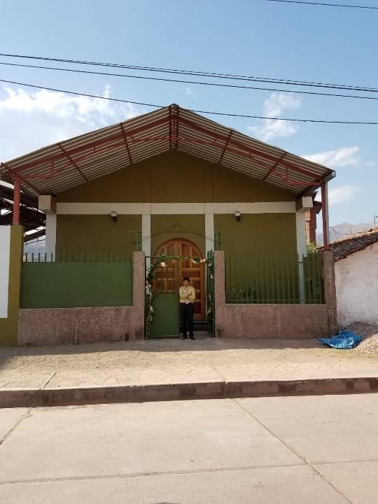 Pastor Celestino in front of Huacarpay Mennonite Church