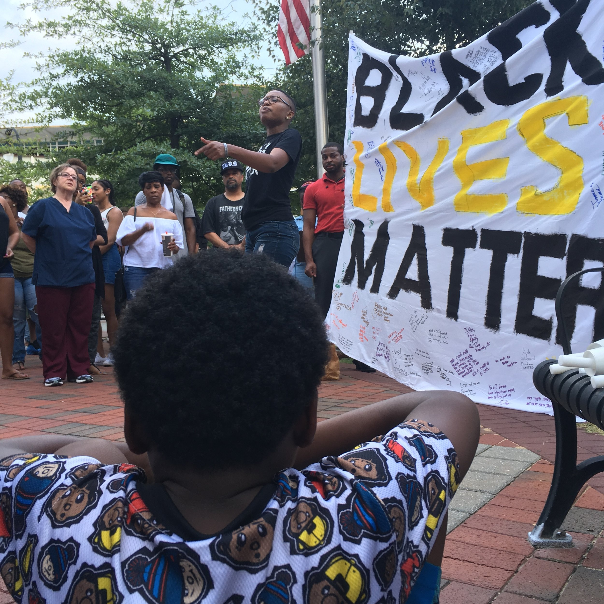 Serenity Hargrove performs  In(formation),   a spoken word poem  at a Black Lives Matter protest in downtown Durham on July 8, 2016.  Photo by Rachel Chang.