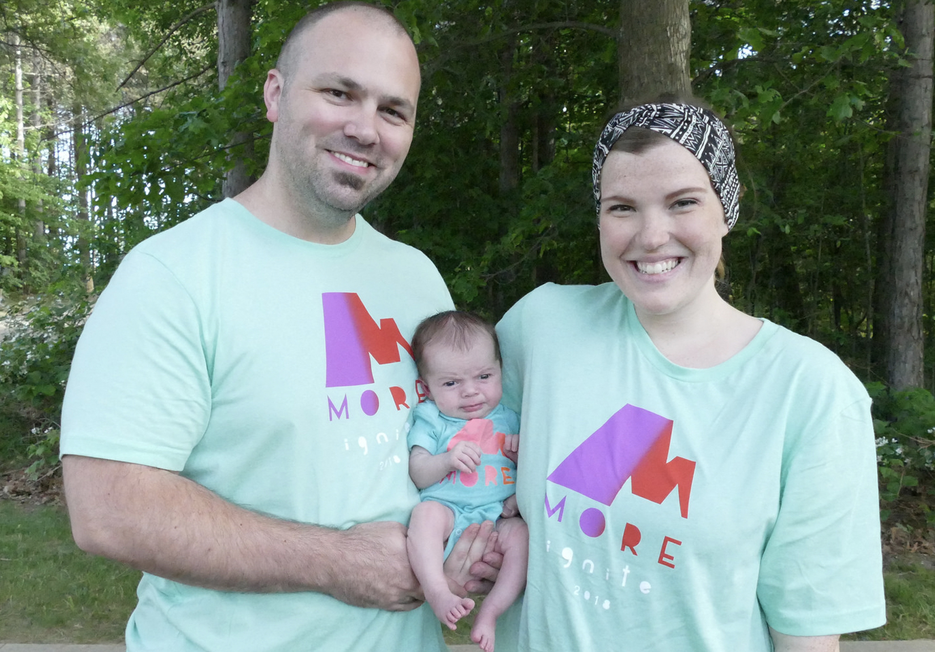 My wife and I with the youngest camper, our two week old daughter.