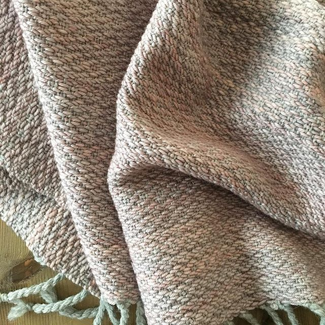 Handwoven blanket for baby niece 💕 Made with wool warp and @madelinetosh ooak dyed wool weft. I think this little gal is gonna love Mad Tosh as much as her mama! . . . . #handwoven #handwoventextiles #ooak #wool #handmade #madtosh #madelinetosh #floorloom #birdseye #twillweave #babylove #weaving #weavingloom