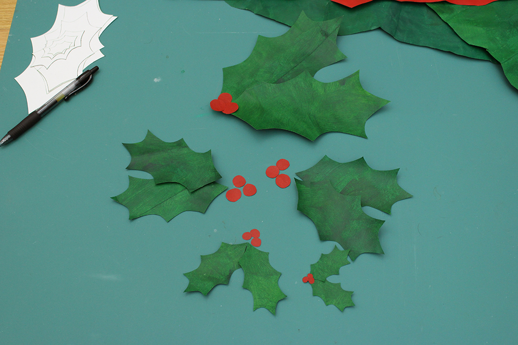Holly leaves and berries are cut out for holly leaf christams decoration