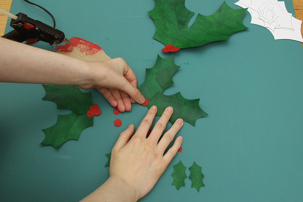 gluing DIY Paper Bag Christmas Holly Leaf Decoration