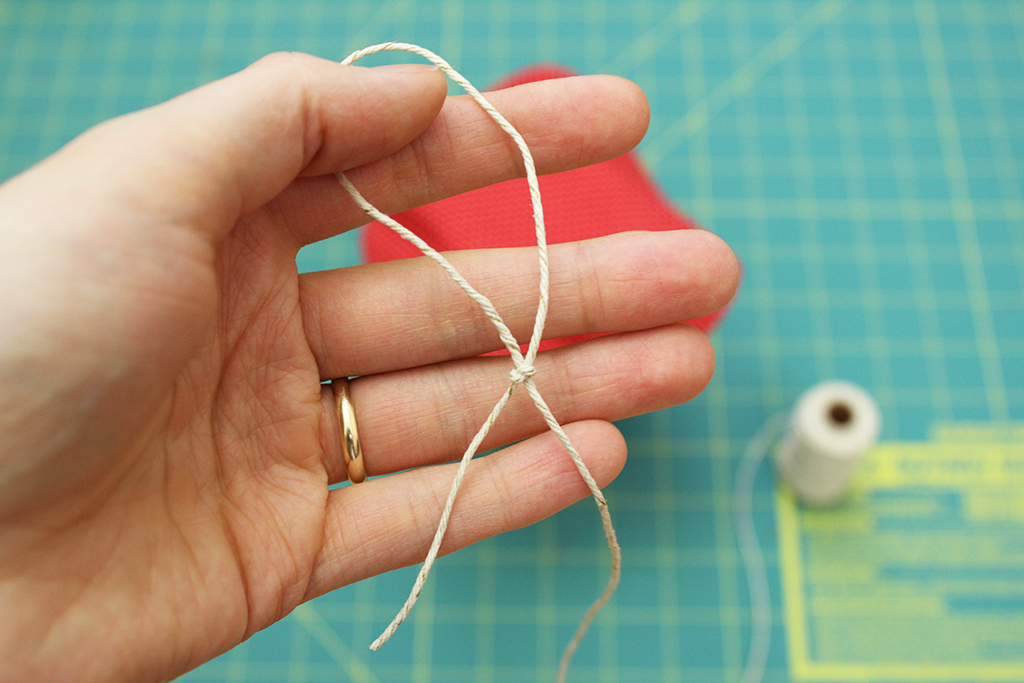Holding a hemp twine slip knot for Vegan Candy Cane Cocoa Mix jar
