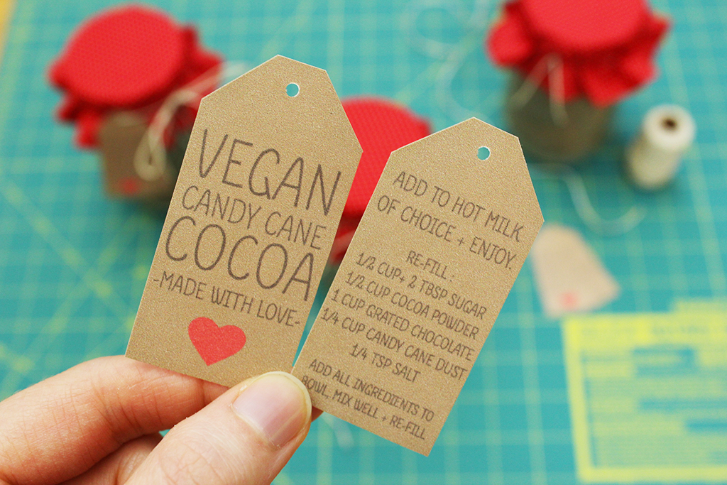 Holding printable Vegan Candy Cane Cocoa Mix jar tags