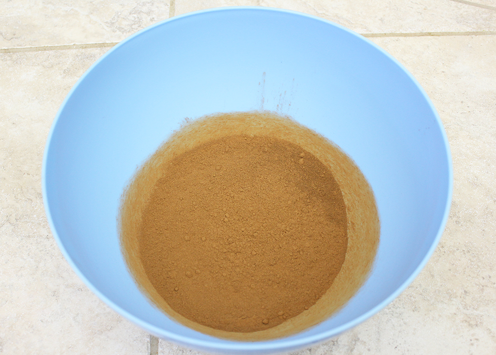 Ground cinnamon in a bowl to make Mini Gingerbread Cookie Garland dough