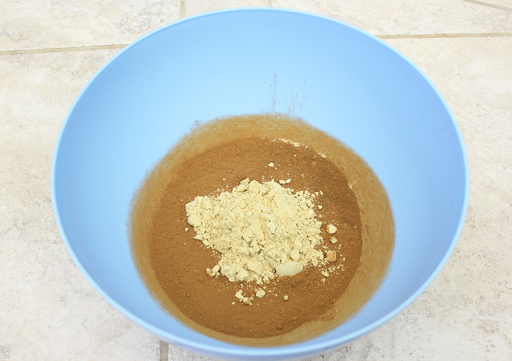 Ground ginger and cinnamon in a bowl to make Mini Gingerbread Cookie Garland dough