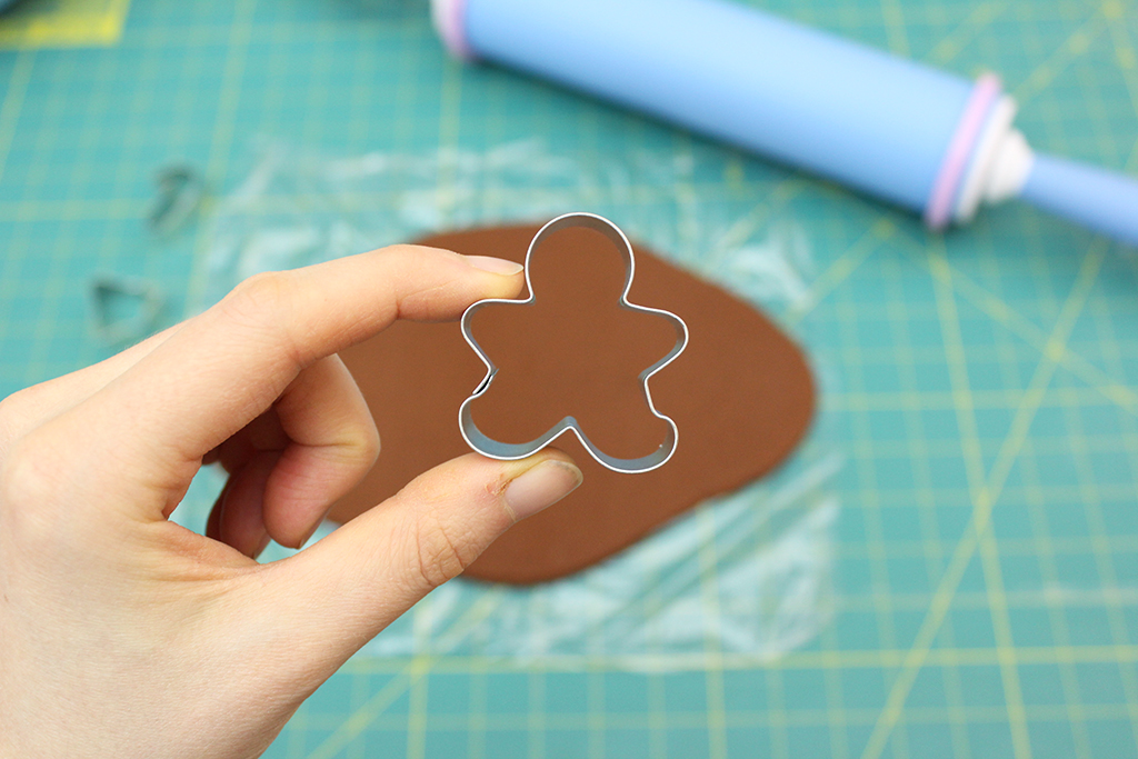 Holding mini cookie cutter for gingerbread cookie garlands