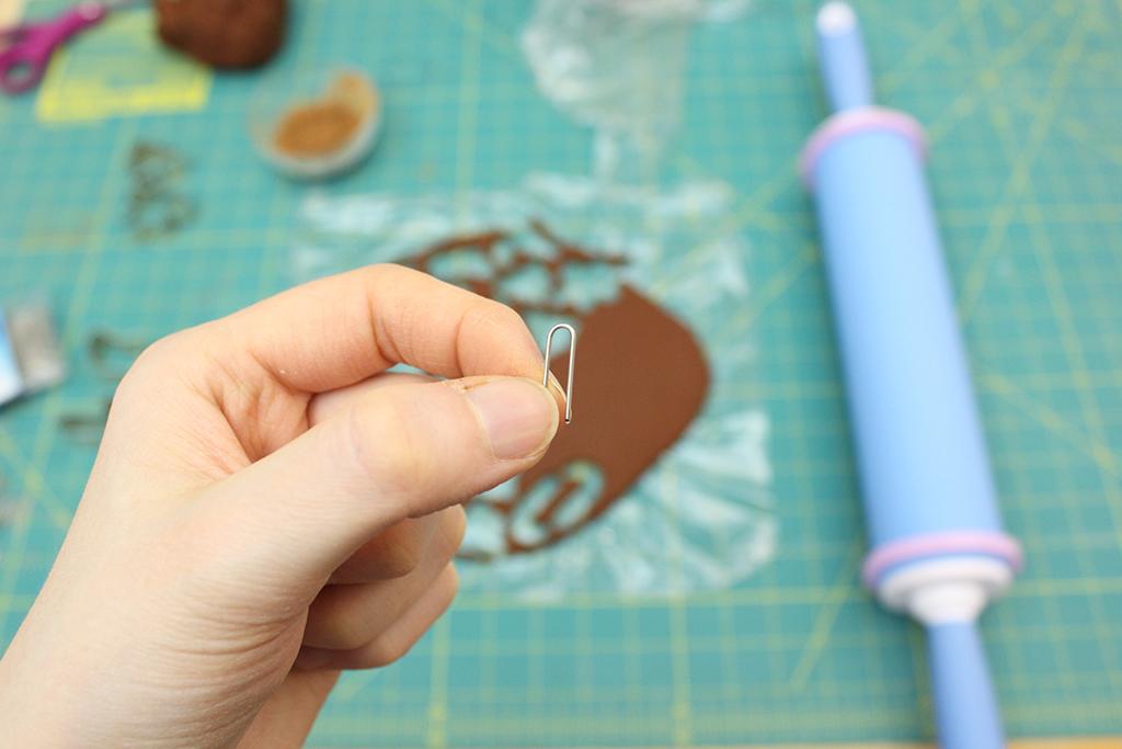 Holding cut paper clip
