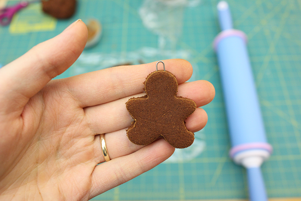 Holding gingerbread man ready to be baked