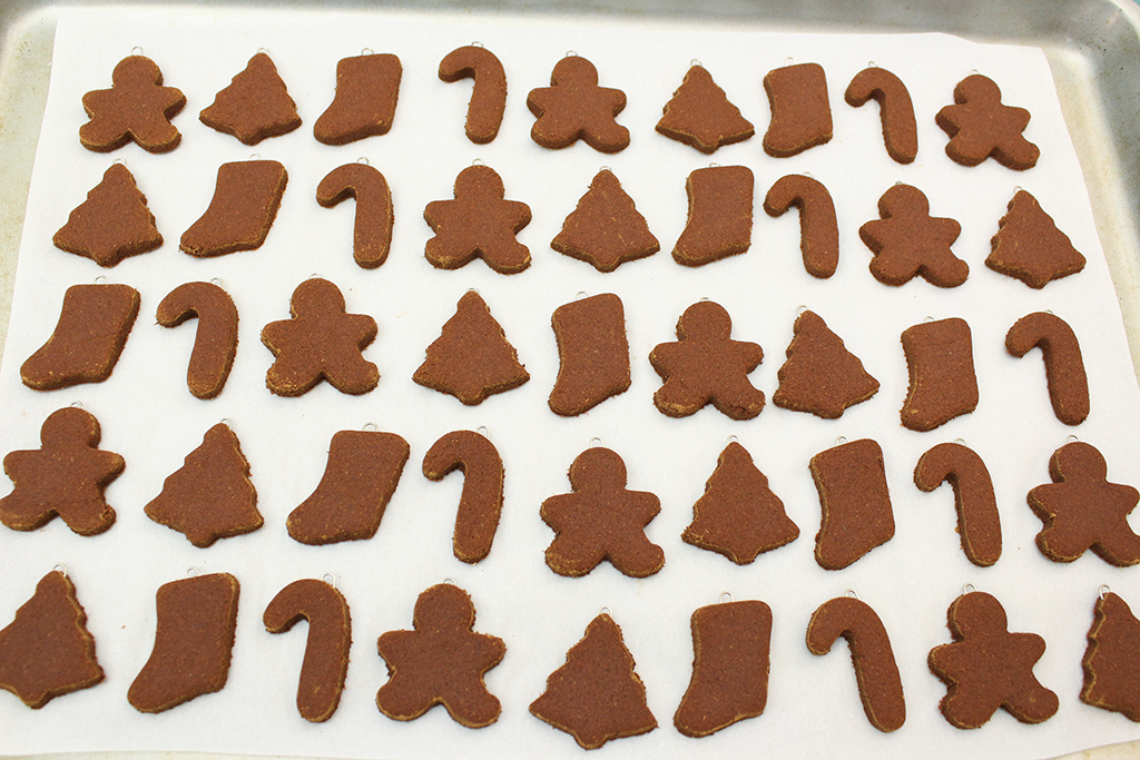 A whole try of gingerbread cookies ready to be baked