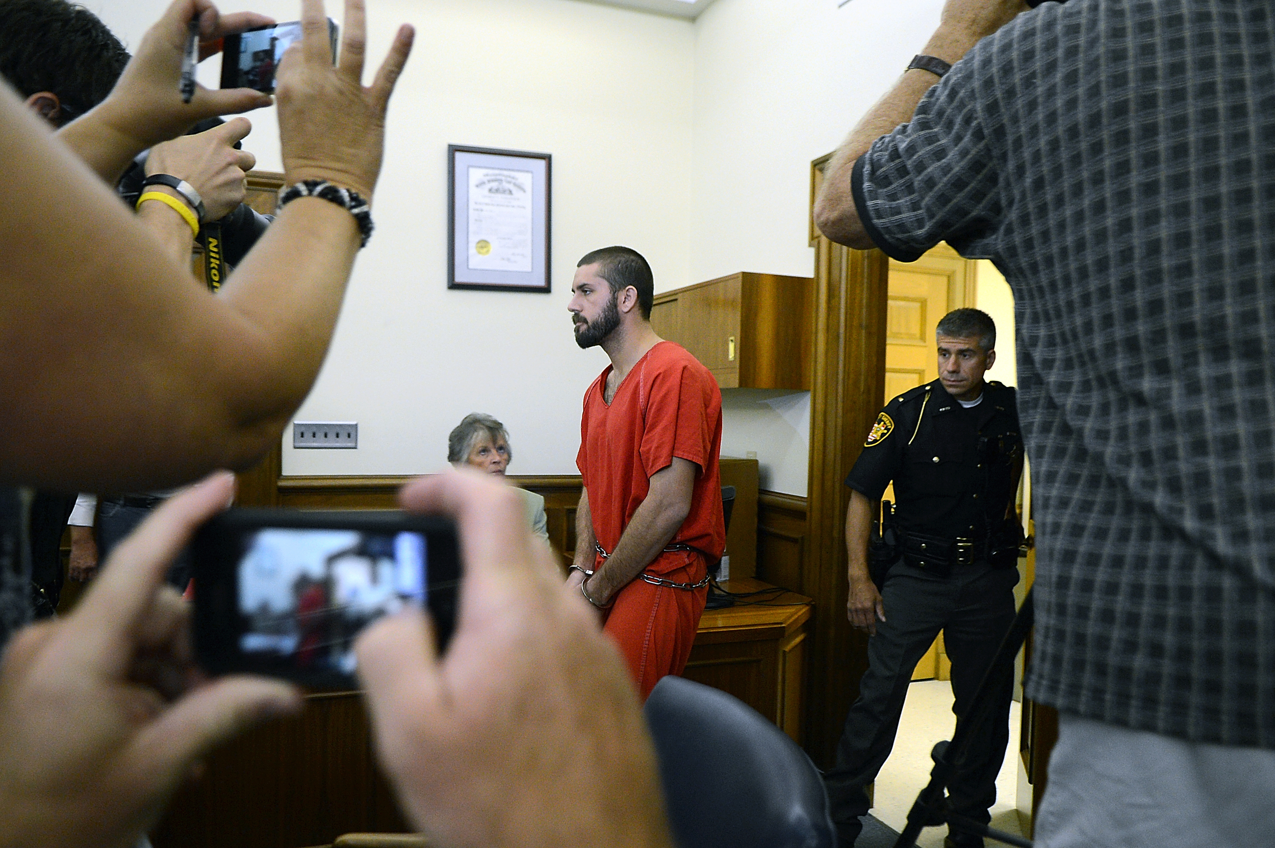 Nate Summerfield enters the courtroom for his hearing at Medina County Common Pleas Court, Friday Aug. 17, 2012, in Medina, Ohio. Summerfield,  who was arrested Wednesday morning in the slaying of his former girlfriend Lynn Jackenheimer, waived his right to extradition at the brief hearing. (Ashland Times-Gazette)