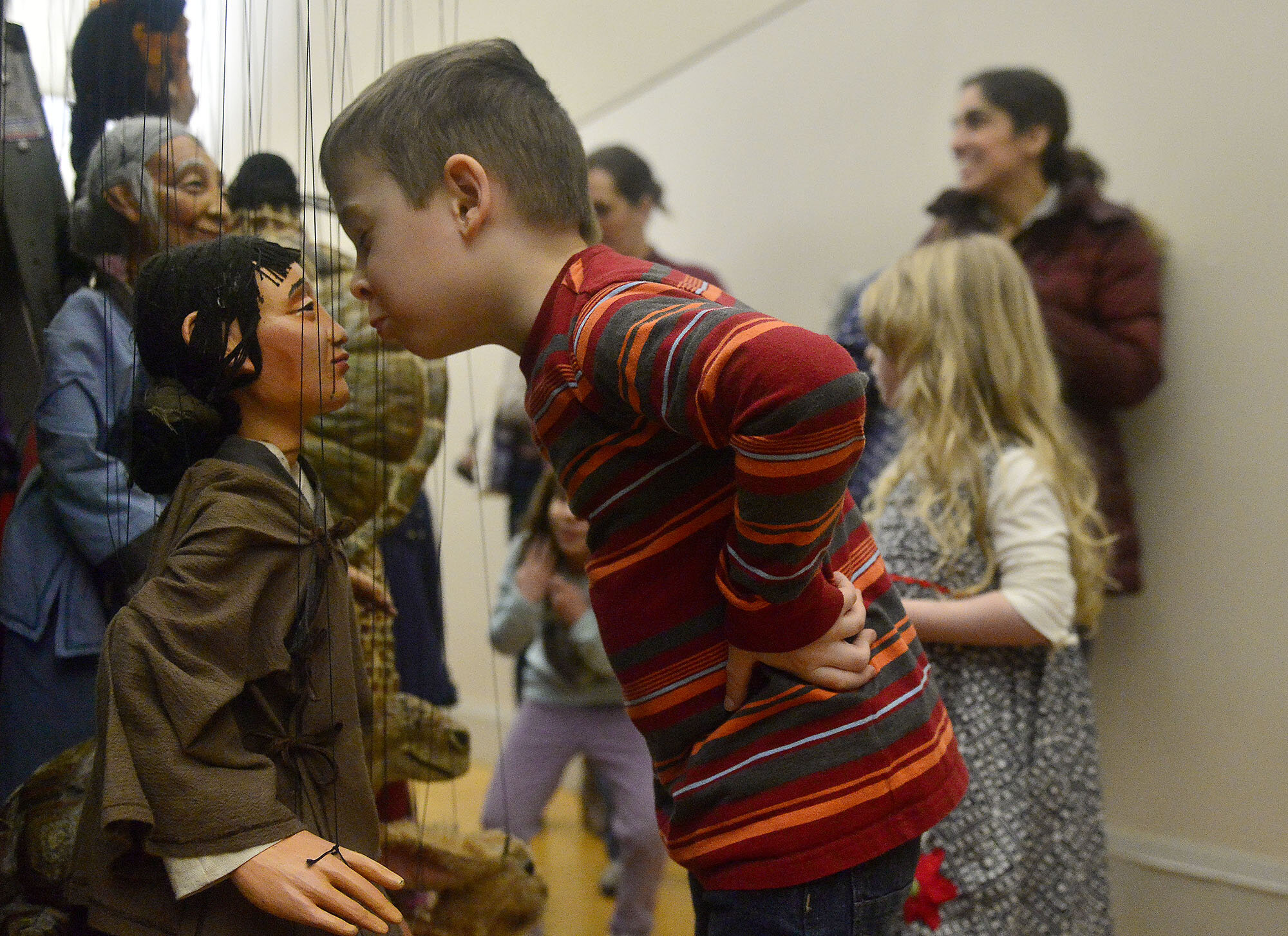 Oscar Stallard, 5 of New London, leans in to pretend kiss a puppet while walking backstage after the Tanglewood Marionette's presentation of The Dragon King on Sunday, February 25, 2018, at the East Lyme Community Center. The show was presented by the East Lyme Puppetry Project and was a fundraiser for the food pantry at Care & Share of East Lyme. (The Day)