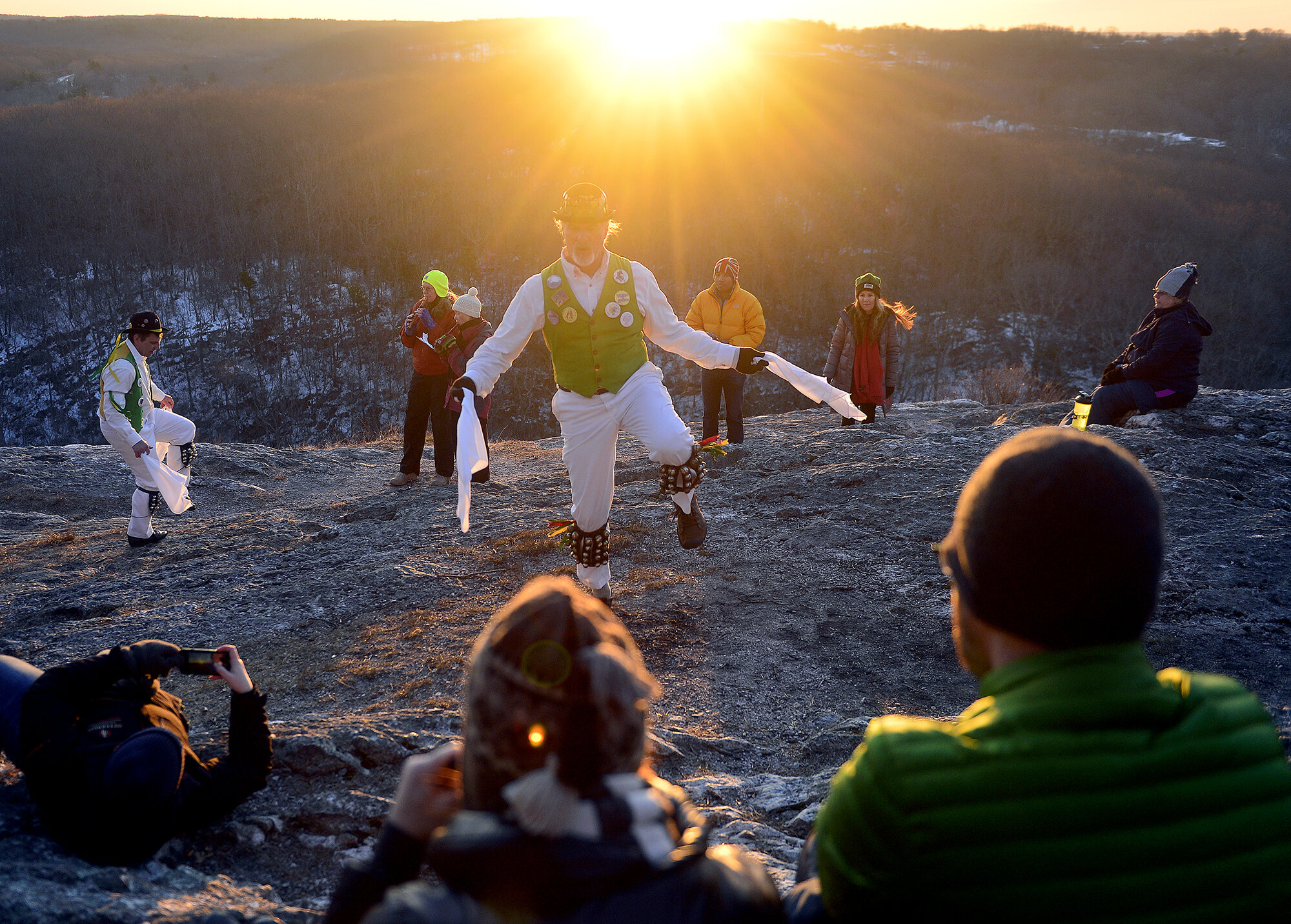 Spectators watch as the Westerly Morris Men mark the sunrise of the first day of spring on Tuesday, March 20, 2018, on top of Lantern Hill in North Stonington. The a traditional English ritual dancing group was founded over 40 years ago and has been performing the rite of spring dances for over 30 years. (The Day)