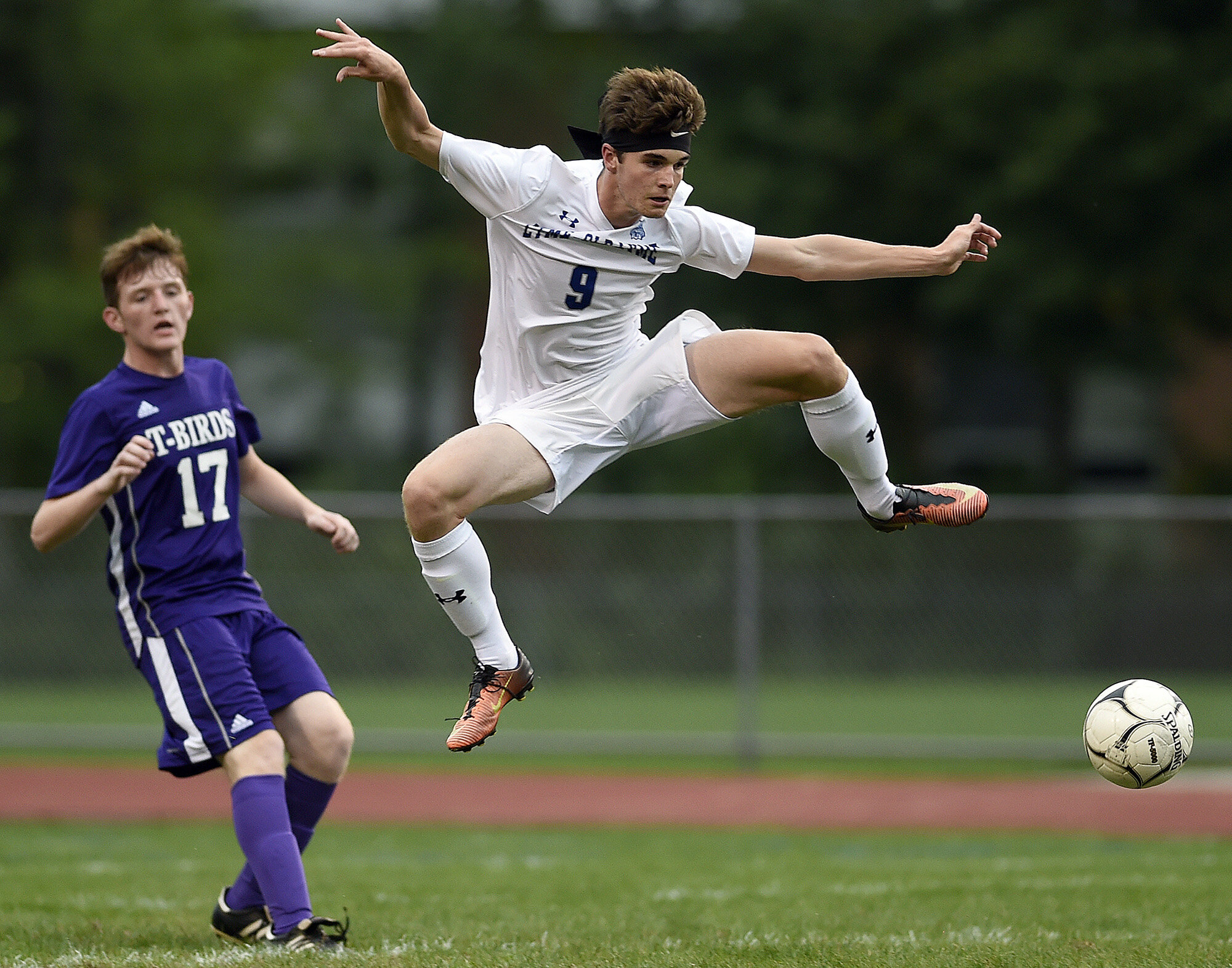 Old Lyme's Rory Cavicke (9) kicks a ball past North Branford's Jason Stanford (17) during a boys soccer game on Thursday, September 12, 2019 at Colafati Field. (The Day)