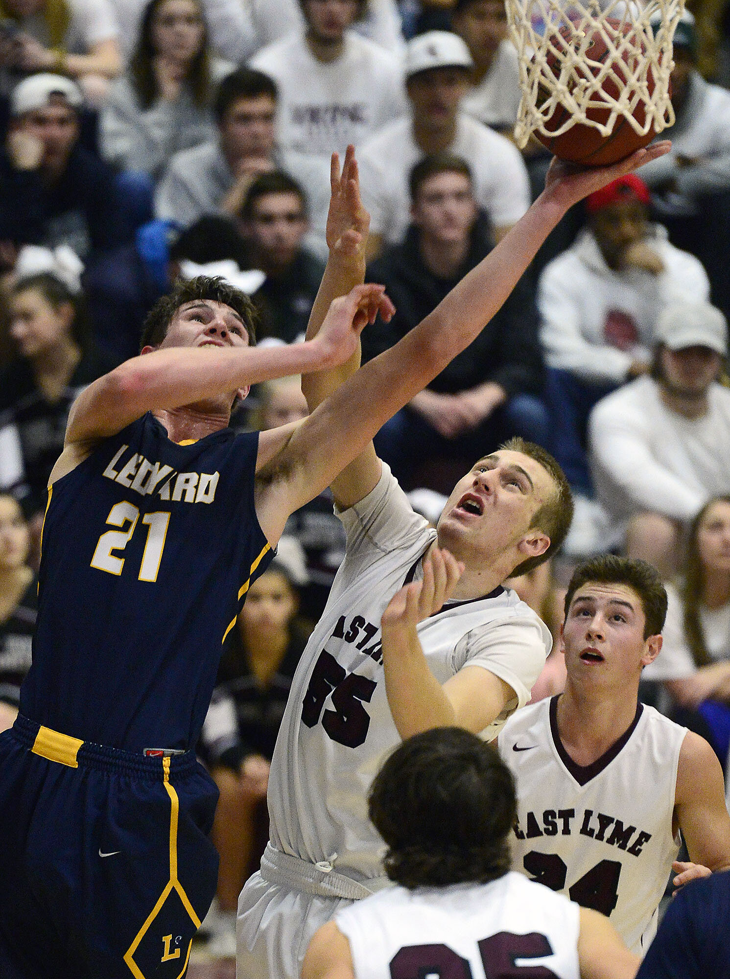 Ledyard's Trevor Hutchins (21) puts up a shot over East Lyme's Jacob Peters (55) during a boys basketball game on Thursday, Jan. 11, 2018, at East Lyme High School. Ledyard won the game 71-55. (The Day)