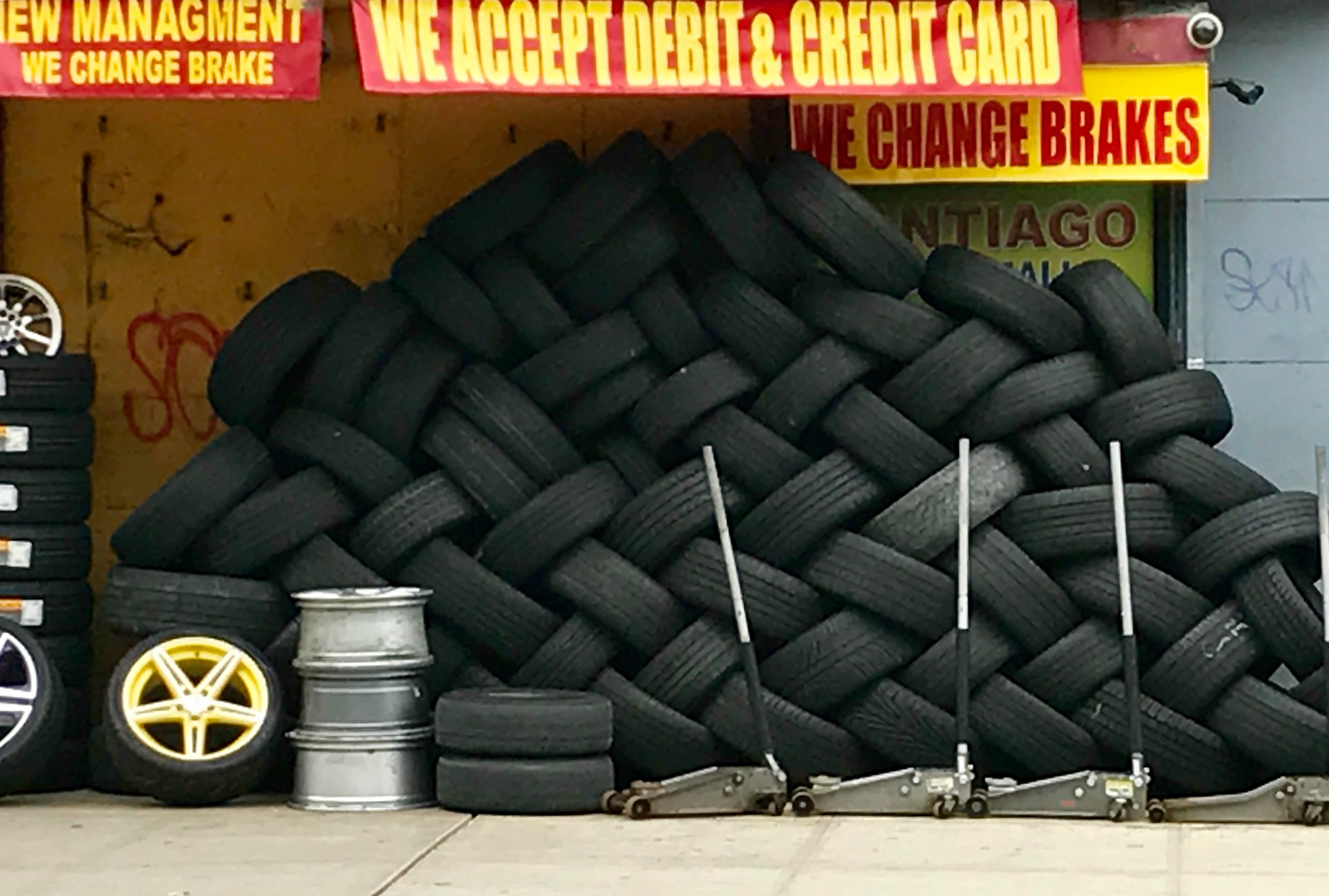 A tire weaving along East 170th across from Claremont Park in the Bronx