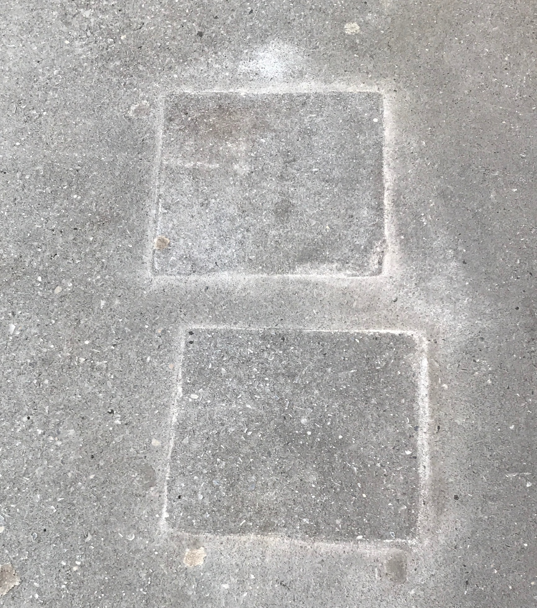 Two blocks etched into the sidewalk along West 72nd Street.