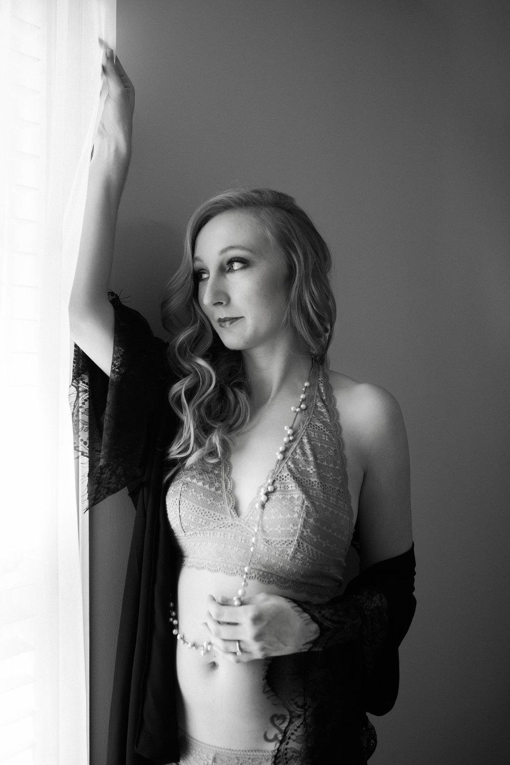 The Story of Angela - I would like to start with my why.I think so many women think of boudoir sessions as something for their significant other but my why's roots where in my self-esteem. I had always wanted to do a session even before I was married because I would see these women and could see their confidence, strength, and beauty in all their pictures. I wanted that feeling and to be able to remind myself when I needed it by looking at those pictures.I was so comfortable right from the very start! From the first message I sent, to the final product, Emma made me feel so comfortable. At our first meeting I was so nervous and I'm not going to lie a little terrified to be discussing taking picture of me in pretty much nothing. But she made sure to get to know me before even diving into the session details, so when it came time to discuss outfits, poses and my