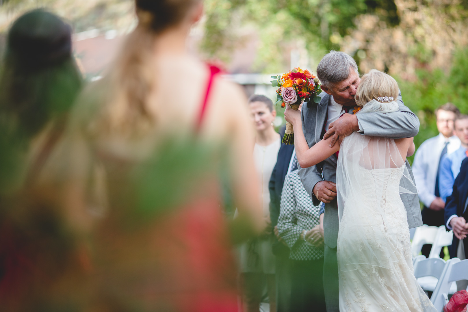 We love this moment between a bride and her father, and here, we use bokeh (the blurriness) to separate the two of them from the rest of the photo in-camera, because this moment belongs to the two of them.