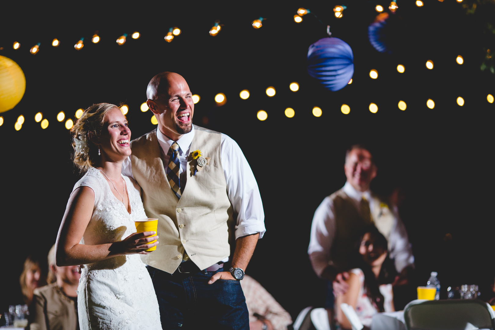 So many of our clients tell us how much they love our candid reception photos. We use off-camera flashes on light stands for evening receptions like this one, and they often become client favorites.