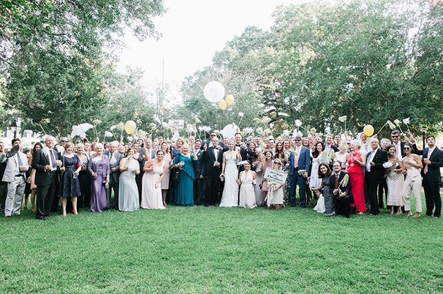 It's a family affair! Wow! We loved gathering all wedding guests to the square outside the Morris Center as we did a room flip! Then follow the group shot with a mini parade? I think so! 📸:@kelibrown