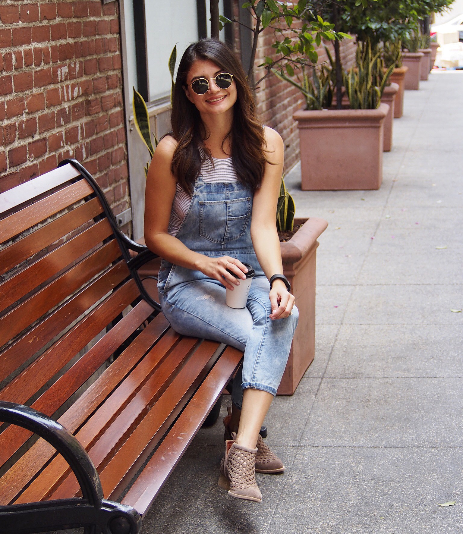 Top: Zara. Overalls: Forever 21. Booties: Jeffrey Campbell. Sunglasses: Ray-Ban