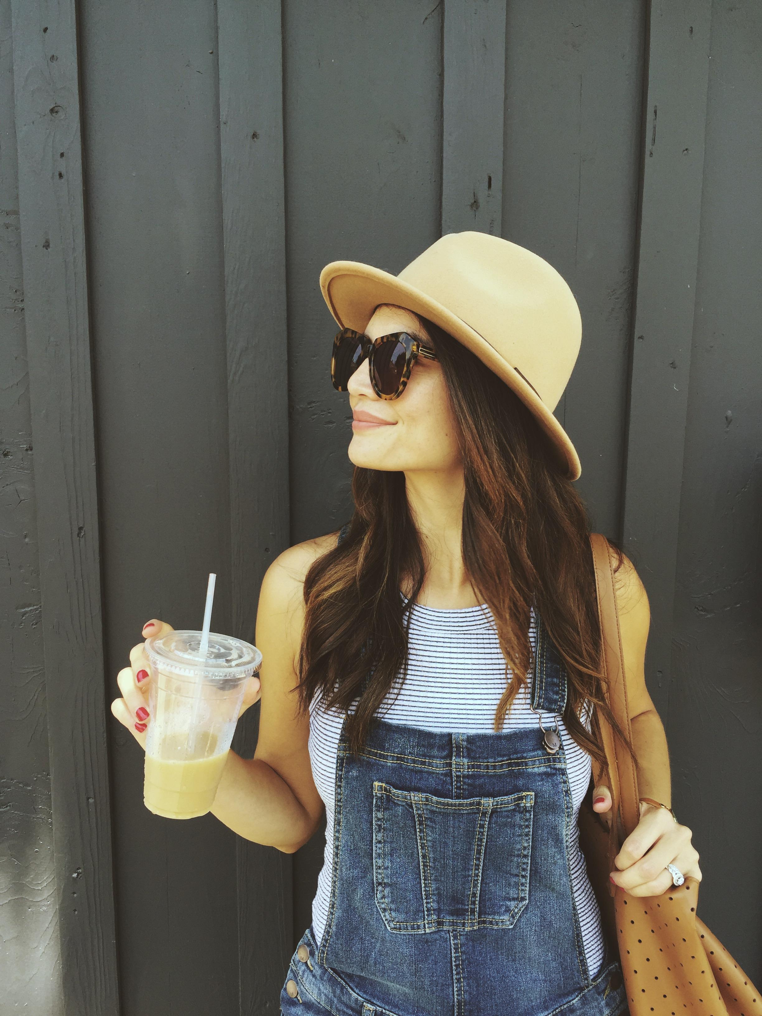 Overalls: Target. Shirt: Zara. Bag: similar  here . Hat: Urban Outfitters, old. Sunglasses:  Karen Walker .