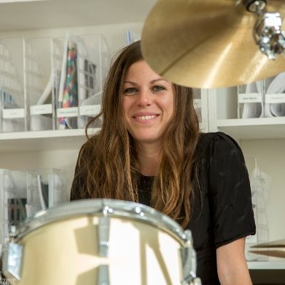 Mindy Abovitz is a self taught drummer and drum machine programmer with a Masters in Media Studies from The New School for Social Research. She started Tom Tom Magazine in 2009. She hopes to impact the music industry through print media, new media, showcases, panels and community interactions and see a 50% increase of female drummers in the next ten years. The magazine has a feminist mission and seeks to raise awareness about female percussionists from all over the world and hopes to inspire women and girls of all ages to drum, while strengthening and building the community of otherwise fragmented female musicians.