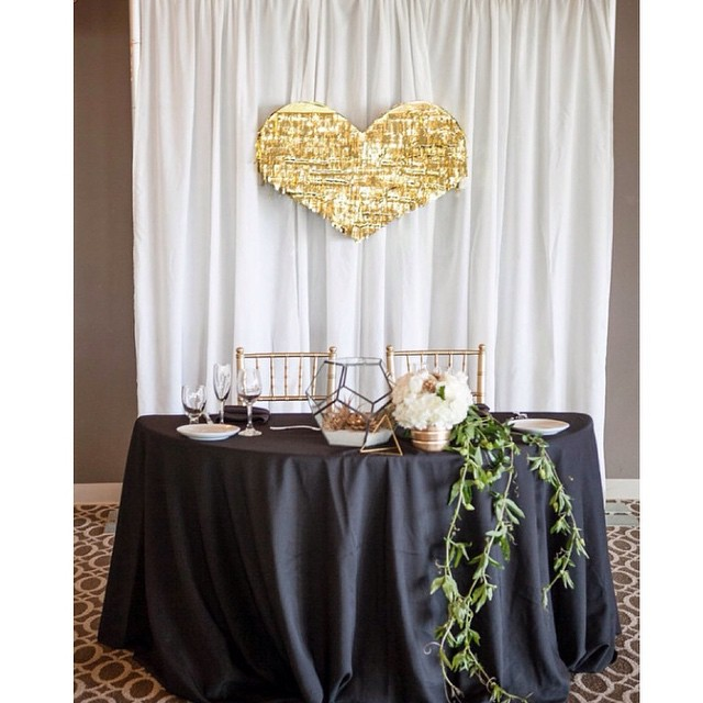 Sample sweetheart table with the coolest gold fringe heart piñata backdrop. #slaytheday_ photo credit: @kristinaleephotography @pixiespetals @glowconceptsfinelinens @losverdesweddings /3-31-15